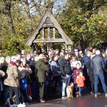 Crowd gathering outside the lychgate of St Marys Church. | Phil Coley