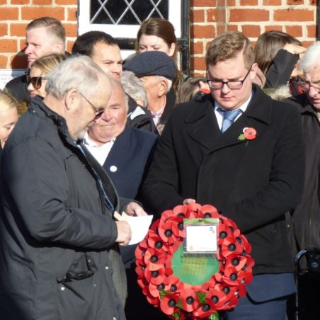 Cllr. Andrew Sheldon lays a wreath on behalf of Rebecca Harris MP. | Phil Coley