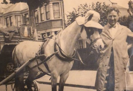A Howard's Dairies milkman and his horse retire