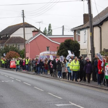 The march going past Salt Box Cottage | Phil Coley