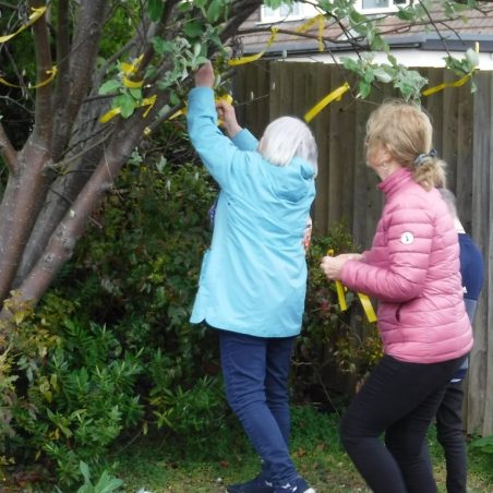 Tying ribbons to the Wishing Tree outside Benfleet Library. | Phil Coley