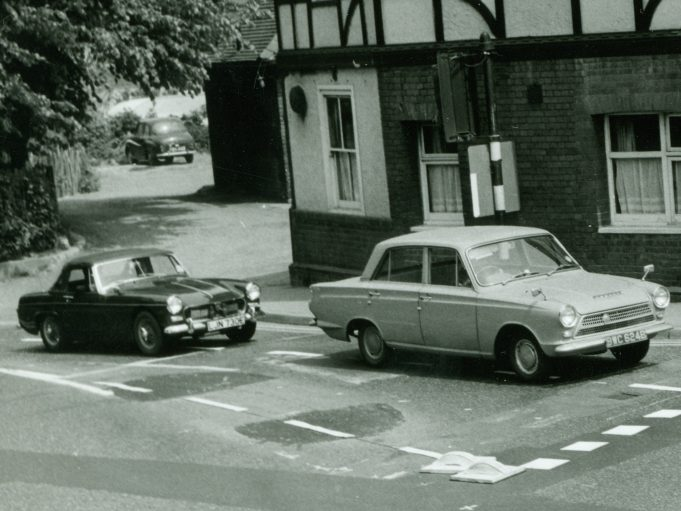 This shows a couple of blocks at the junction and the disabled traffic lights. For twitter followers who struggled with the previous pictures to find out what cars are in the picture the one in the car park does look like an Austin A35. | CPDC