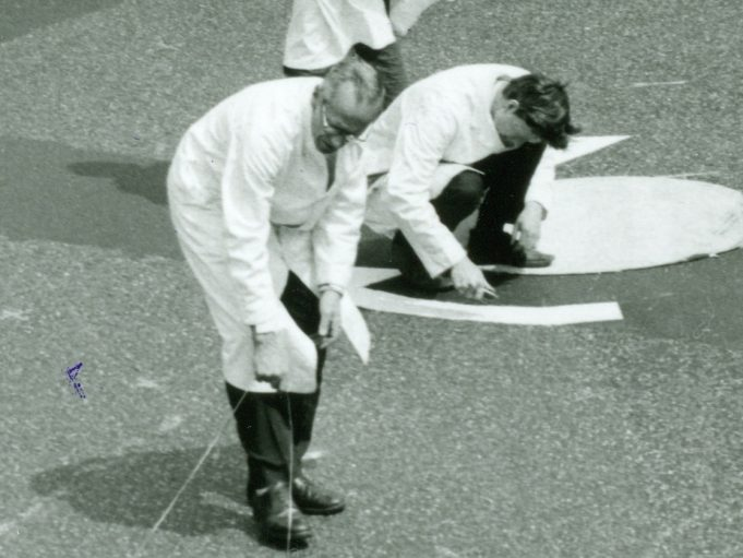 This part of a photo shows the older member of the team laying out a line. We presume this to be Frank Blackmore. | CPDC