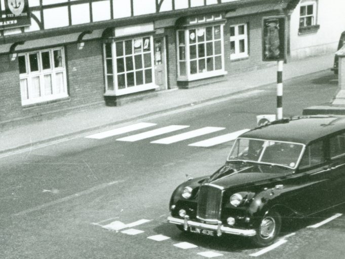The traffic lights are clearly shown as being disabled and a block is shown. For car fans the car is a Vanden Plas.   CPDC