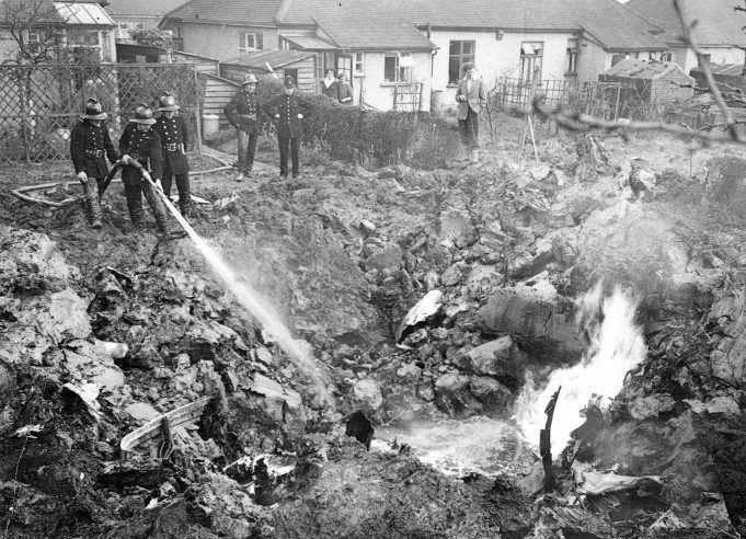 Firemen hosing down the wreckage of the crashed Gloster Meteor | Echo newspaper archive